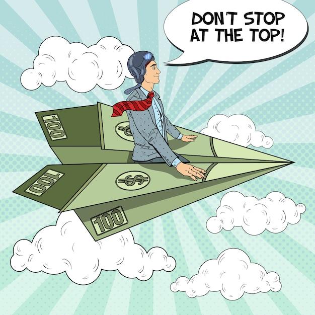 Поп-арт успешный бизнесмен, летящий на долларовом бумажном самолетике. Premium векторы