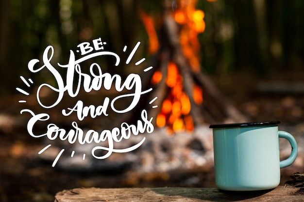 Positive lettering with photo of campfire and mug Free Vector