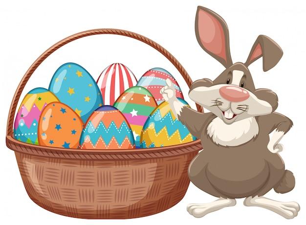 Design del poster per pasqua con coniglietto e uova di pasqua Vettore gratuito