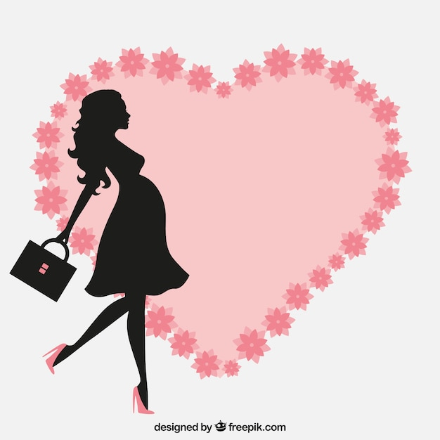 Pregnant woman with a floral heart Vector | Free Download