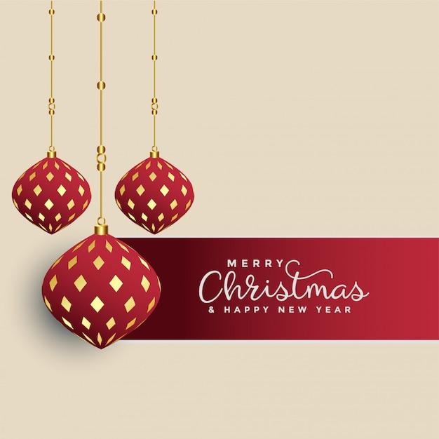 Premium christmas greeting with hanging decorative xmas balls Free Vector