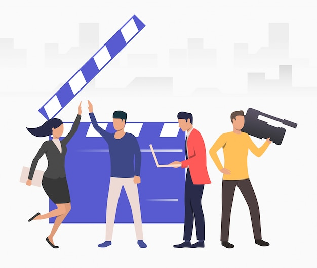 Presenters giving hi five in studio Free Vector