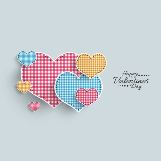 Pretty background with checkered hearts Premium Vector