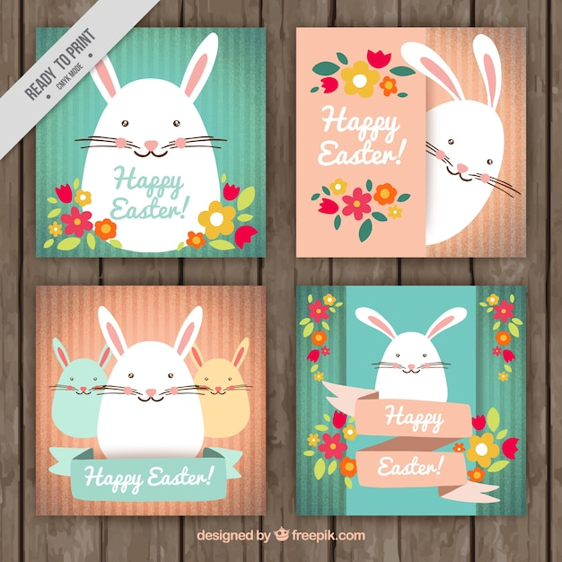 Pretty easter cards with bunnies and flowers Free Vector