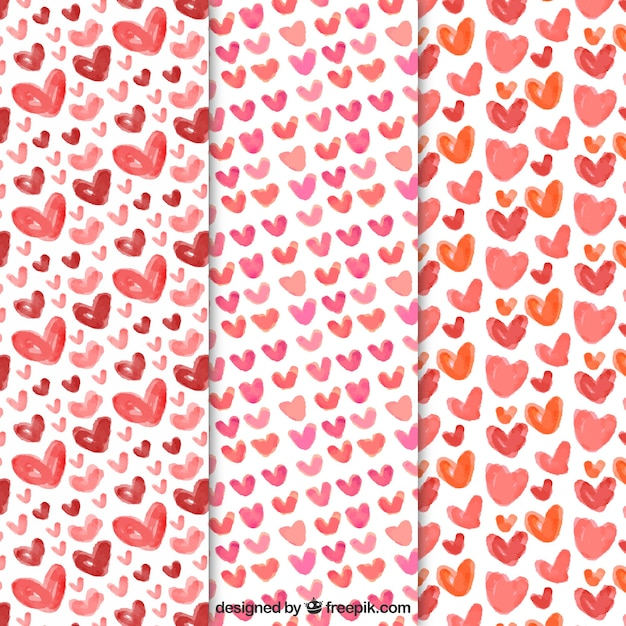 Pretty patterns of watercolor hearts Free Vector