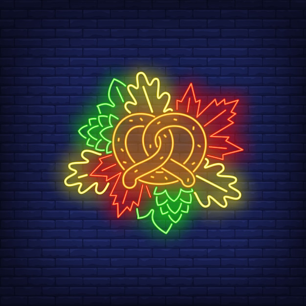 Pretzel and autumn leaves neon sign Free Vector