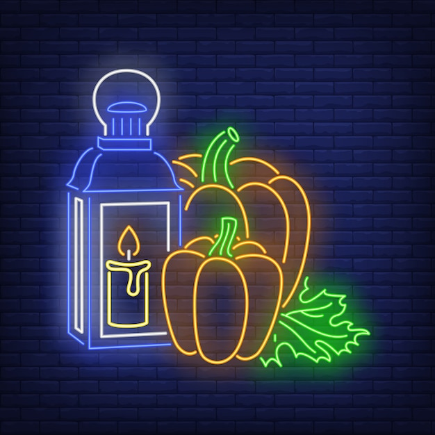 Pumpkins and lantern with candle neon sign Free Vector