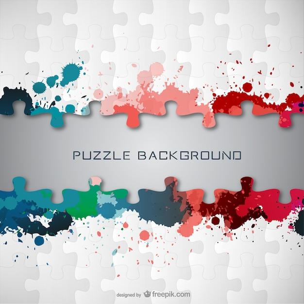 Puzzle pieces with paint stains Premium Vector