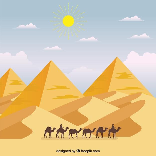 キャラバンとピラミッドの風景 無料ベクター