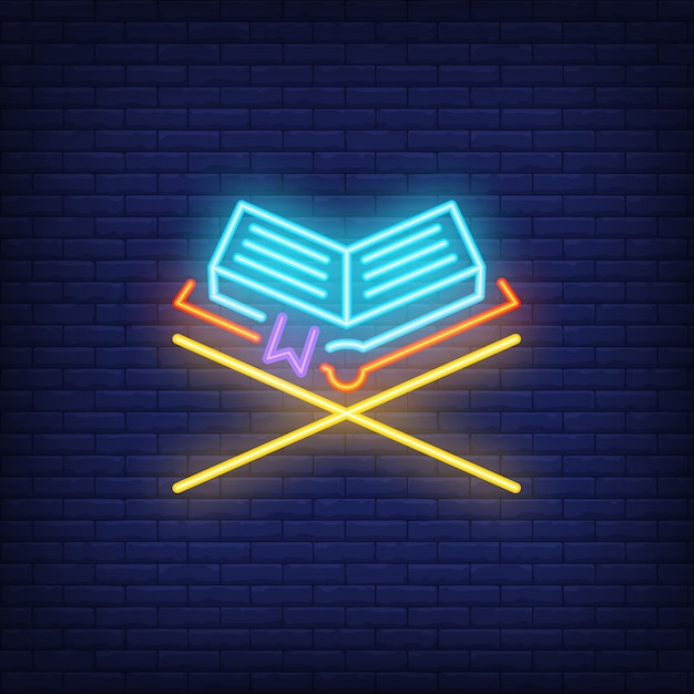 Quran neon sign.holy book on wooden stand. night bright advertisement. Free Vector