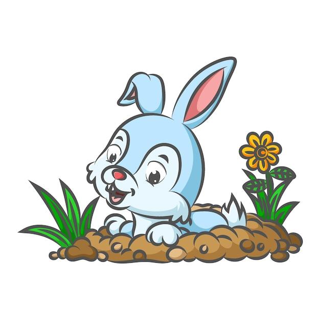 庭に穴を開けるために地面を掘るウサギ Premiumベクター