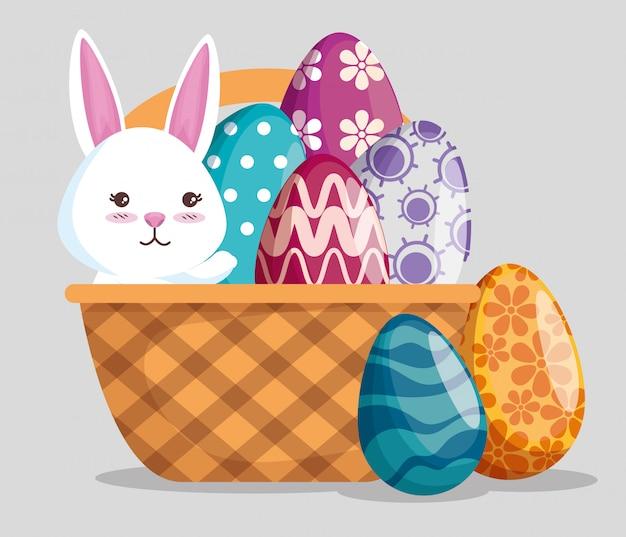 Кролик с украшением яиц в корзине на мероприятие Бесплатные векторы
