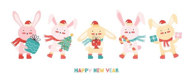 クリスマスツリーとギフトとサンタの帽子のウサギ Premiumベクター
