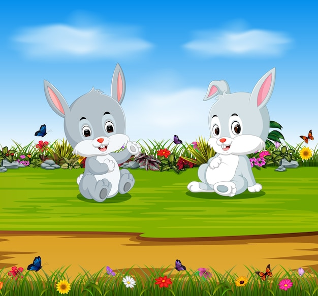 Rabbits relax in the sunny day with full stomach Premium Vector