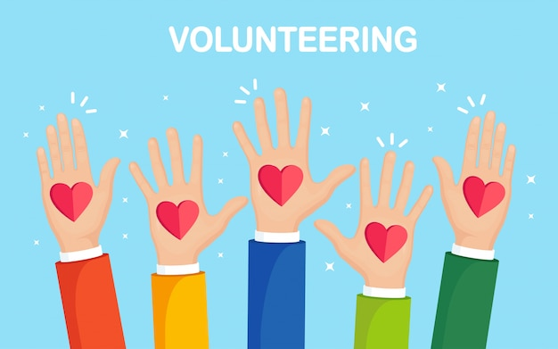 Поднятые руки с красным сердцем. волонтерство, благотворительность, концепция сдачи крови. благодарю за заботу. голосование толпы. Premium векторы