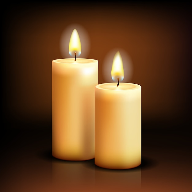 Ralistic candles at dark Free Vector