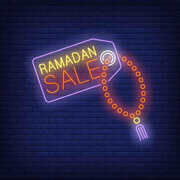Ramadan sale neon text on tag with prayer beads Free Vector