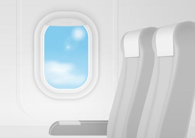 リアルな飛行機輸送インテリア。座席内の航空機は窓の近くの椅子に座ります。ビジネスクラスの旅行のコンセプト Premiumベクター