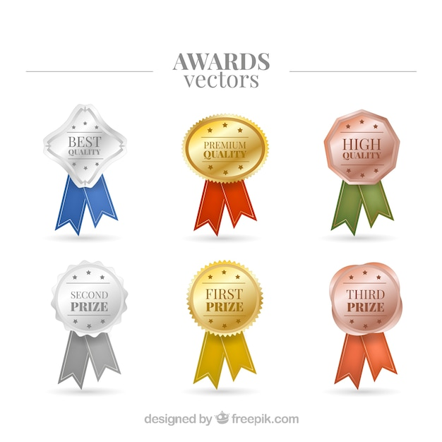 Realistic and bright awards Free Vector