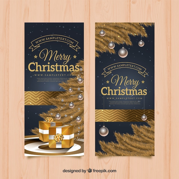 Realistic banners with a golden christmas tree