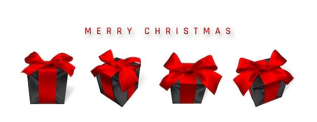 白で隔離の赤い弓と現実的な黒のクリスマスギフトボックス Premiumベクター