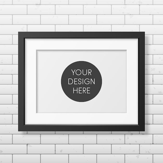 Realistic black frame a4 on the brick wall Premium Vector