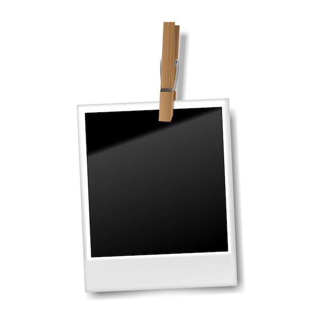 Realistic blank retro photo frame with wooden clip, vector illustration Premium Vector