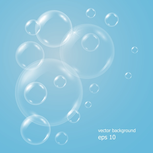 Realistic blue background with transparent soap water bubbles, balls or spheres. Premium Vector