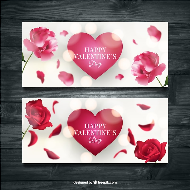 Realistic bokeh banners with hearts and flowers Free Vector