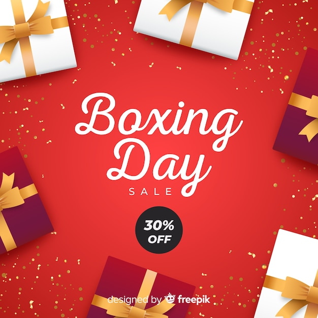 Realistic boxing day sale background Free Vector
