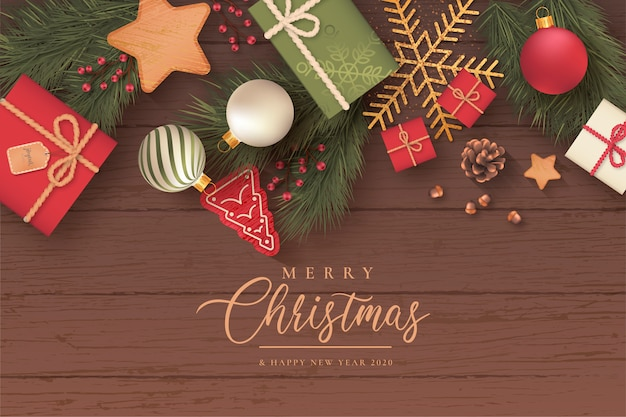 Realistic christmas background with cute ornaments Free Vector