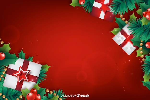 Realistic christmas background with gift boxes Free Vector