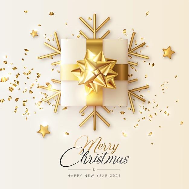 Cartolina d'auguri realistica di natale e capodanno con regalo dorato e fiocchi di neve Vettore gratuito