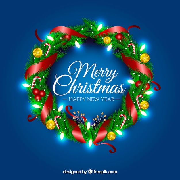 Realistic christmas wreath with shiny lights Free Vector