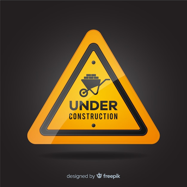 Realistic under construction road sign Free Vector