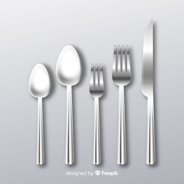 Realistic cutlery background Free Vector