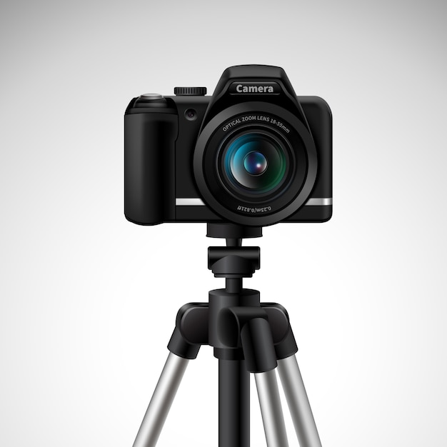 Realistic digital photo camera on tripod Free Vector