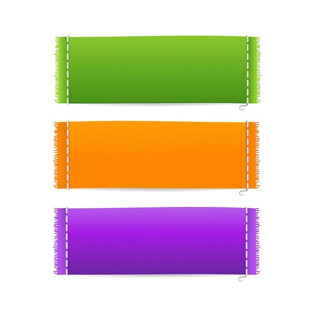 현실적인 패브릭 의류 레이블을 설정합니다. 텍스트를위한 공간이있는 레이블 중 세 개. 프리미엄 벡터