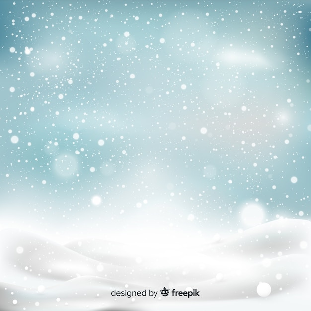 Realistic falling snowflakes in sky background Free Vector