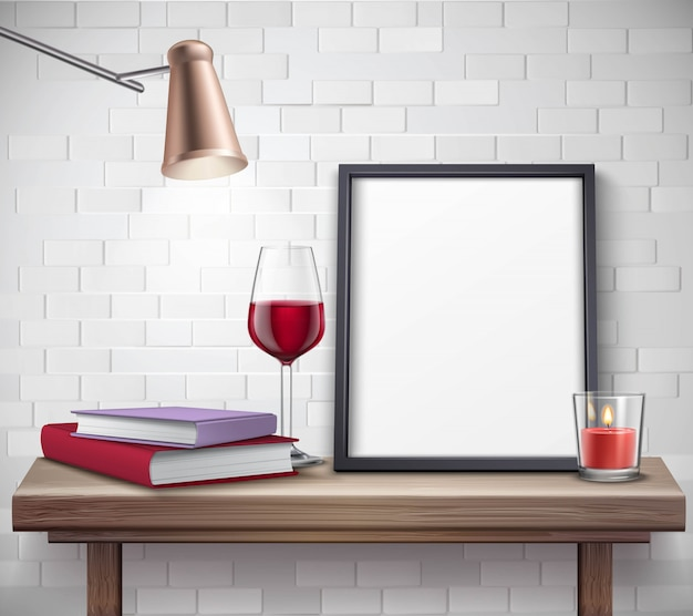 Realistic frame template on the table with glass of wine candle lamp and books Free Vector