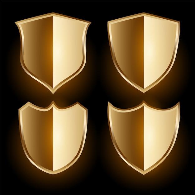Realistic golden shield badges set Free Vector