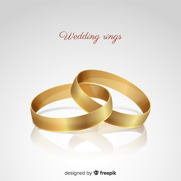 Realistic golden wedding rings background Free Vector
