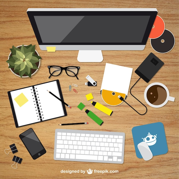 Realistic graphic designer desktop in top view Free Vector
