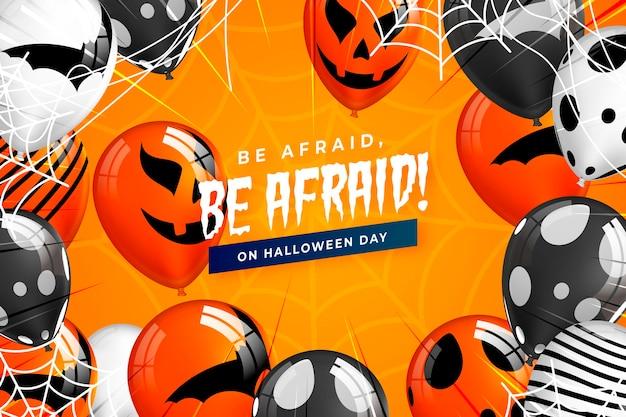 Реалистичная хэллоуин тыква фон с сообщением «бойся» Бесплатные векторы
