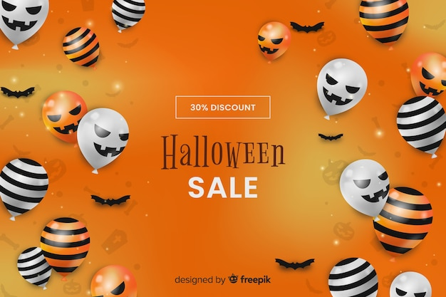 Realistic halloween sale background with balloons Free Vector