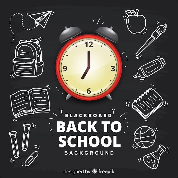 Realistic and hand drawn back to school background Free Vector