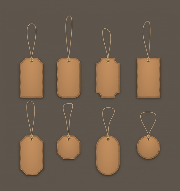 Realistic hanging leather labels Premium Vector