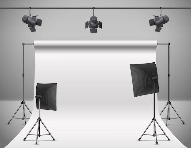Realistic illustration of empty photo studio with blank white screen, lamps, flash spotlights Free Vector