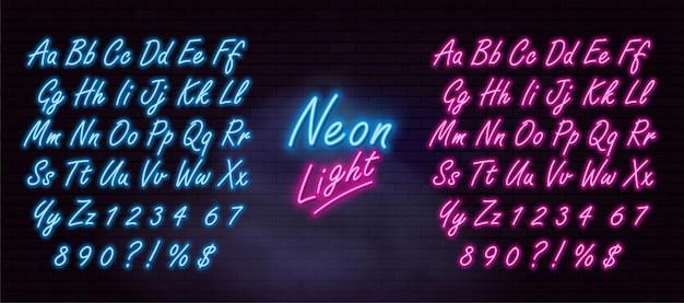 어두운 벽돌 벽에 현실적인 네온 알파벳입니다. 프리미엄 벡터