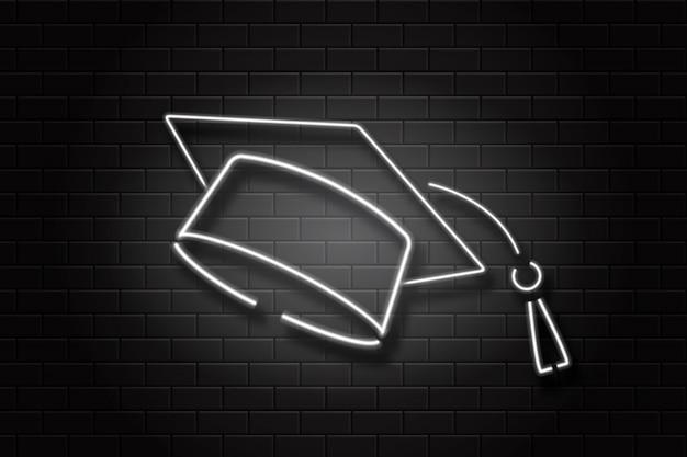 装飾とカバーのための壁の背景に現実的なネオンサイン卒業の帽子。教育、卒業、学校に戻るの概念。 Premiumベクター